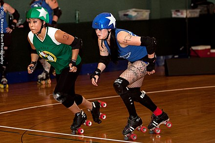 Two jammers (from the Oly Rollers and Rainy City) race from the jammer line TwoNorthWestJammers.jpg