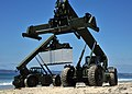Two U.S. Navy rough terrain container handlers move supplies off an Improved Navy Lighterage System, not shown, during a maritime prepositioning force training scenario June 13, 2013, in Coronado, Calif., as 130613-N-OP638-046.jpg