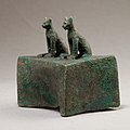 Two cats surmounting a box for an animal mummy MET 04.2.601 EGDP014447.jpg