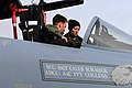 U.S. Air Force Airman 1st Class Ivy Collins, background, a crew chief with the 748th Aircraft Maintenance Squadron, talks to Lt. Col. Mike Casey, commander of the 493rd Fighter Squadron, before an F-15C Eagle 130116-F-BH151-152.jpg