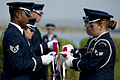 U.S. Airmen with the Hickam Honor Guard fold a U.S. flag during the ash scattering ceremony of retired U.S. Air Force Senior Master Sgt. Raymond L. Perry 121207-F-ZB240-401.jpg