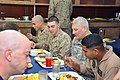 U.S. Army Gen. Carter F. Ham, second from right, the commander of U.S. Africa Command, eats a meal with Marines assigned to the 24th Marine Expeditionary Unit aboard the multipurpose amphibious assault ship USS 120416-N-H2341-080.jpg
