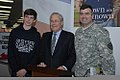 U.S. Army Lt. Col. James Harwood, right, the regional defense counsel for Yongsan Garrison, and his son stand with Donald Rumsfeld during a book signing for Rumsfeld's memoir at the Yongsan Garrison post 111013-A-EU406-004.jpg