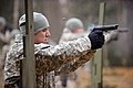 U.S. Army Sgt. 1st Class Jose J. Mejia, assigned to the 615th Military Police (MP), 18th MP Brigade, fires an M9 pistol during weapons qualification at the 7th Army Joint Multinational Training Command's (JMTC) 140113-A-HE359-015.jpg