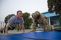 U.S. Army Sgt. Alexander Cerney, left, an infantryman with the 4th Brigade Special Troops Battalion, 4th Brigade Combat Team, 101st Airborne Division, prepares to do push-ups while Master Sgt. Theodore Cook 130714-A-DQ133-517.jpg