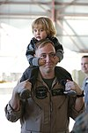 U.S. Marine Corps Capt. William R. Houck with Marine Aerial Refueler Transport Squadron (VMGR) 352, Marine Aircraft Group (MAG) 11, 3rd Marine Aircraft Wing (MAW), holds his son on his shoulders on Marine Corps 140115-M-DF987-299.jpg