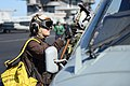 U.S. Navy Aviation Electrician's Mate 3rd Class Joanna Ward, assigned to Helicopter Sea Combat Squadron (HSC) 7, cleans the windows of an MH-60S Seahawk helicopter on the flight deck of the aircraft carrier 131111-N-MV682-047.jpg