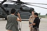 U.S. Navy Lt. Dominic Simone, center, an MH-53E Sea Dragon helicopter pilot with Helicopter Mine Countermeasures Squadron (HM) 15, Detachment 2, poses for a photo before taking off from Ghazi Aviation Base 100821-M-ZG155-280.jpg