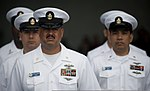 U.S. Navy chief petty officers stand at parade rest during a burial at sea aboard the aircraft carrier USS Carl Vinson (CVN 70) June 28, 2013, in the Pacific Ocean 130628-N-GZ277-118.jpg
