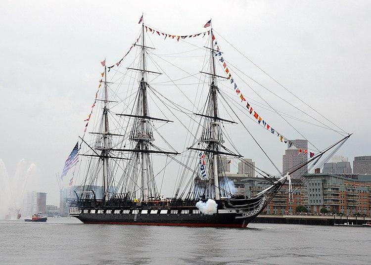 USS Constitution fires a 17-gun salute