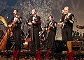 US Navy 011200-N-0773H-002 Country Current is among the ensembles featured during the United States Navy Band's holiday television special.jpg