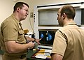 US Navy 030820-N-9593R-004 U.S. Navy doctors Lt. Cmdr Ralph Pickard, left, and Ens. Jesse Rohloff study a patient's mammography film at the National Naval Medical Center in Bethesda, Md.jpg