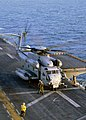 US Navy 031006-N-6895M-002 A CH-53 Sea Stallion lifts off from the flight deck of USS Peleliu (LHA 5).jpg