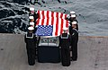 US Navy 040214-N-8595B-025 Pallbearers for Cdr. Robert J. Sanderson (Ret.) conduct a burial at sea ceremony.jpg