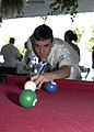 US Navy 040426-N-6268K-005 Airman John Madore from Oklahoma City, Okla., plays a game of pool on the Ft. Lauderdale's beach boardwalk.jpg