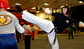 US Navy 040706-N-7130B-001 Senior Chief Yeoman Scott Baker, from Clinton, Mo., a 4th degree black belt and certified Tae Kwon Do instructor, spars with a student during a class held nightly aboard USS Ronald Reagan (CVN 76).jpg