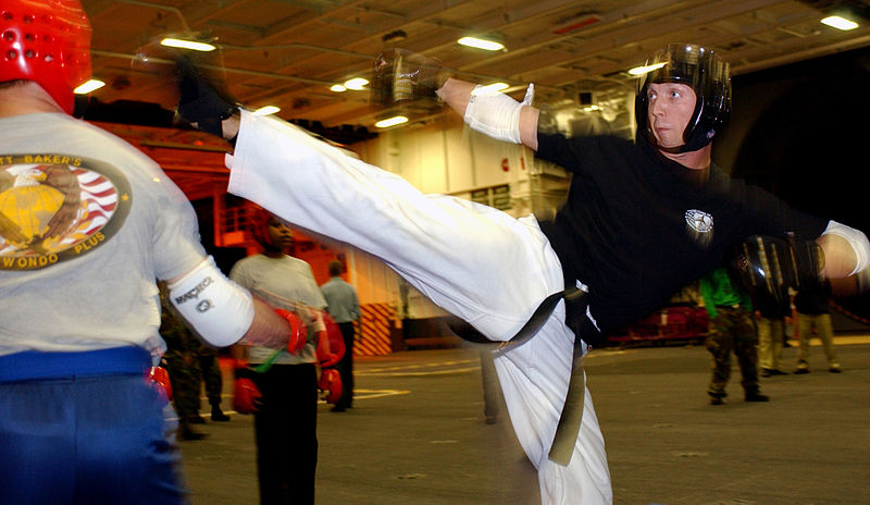 File:US Navy 040706-N-7130B-001 Senior Chief Yeoman Scott Baker, from Clinton, Mo., a 4th degree black belt and certified Tae Kwon Do instructor, spars with a student during a class held nightly aboard USS Ronald Reagan (CVN 76).jpg