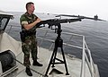 US Navy 040714-N-8977L-012 Master-at-Arms 3rd Class Rick Bolander of Marquette, Mich., mans a 7.62mm M-60 machine gun aboard the patrol catamaran Defender One.jpg
