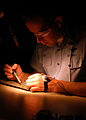 US Navy 050405-N-8497H-001 Aviation Electronics Technician 1st Class Jovan Gates practices soldering on a test panel at the Center for Naval Aviation Technical Training Unit on board Naval Air Station Whidbey Island, Wash.jpg