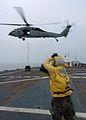 US Navy 050421-N-8629M-005 Aviation Boatswain's Mate 3rd Class Brandon Reyes guides an MH-60S Seahawk helicopter.jpg