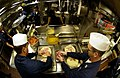 US Navy 050423-N-4309A-106 Members of the First Class Petty Officer's Association, stationed aboard the guided missile destroyer USS O'Kane (DDG 77), diligently work to make pizzas for the crew.jpg
