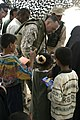 US Navy 050512-M-9708S-011 Cmdr. Dale C. White, assigned to Regimental Combat Team Eight and Regimental Chaplains, passes out toys donated by supporting Americans, to local Iraqi children.jpg