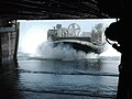 US Navy 060421-N-7028M-001 During wet well operations, Landing Craft Air Cushion Seven Two (LCAC 72) assigned to Assault Craft Unit Five (ACU-5) steers into the well deck of the amphibious assault ship USS Peleliu (LHA 5).jpg