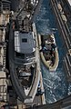 US Navy 060517-N-9851B-003 A Rigid Hull Inflatable Boat is lowered from a boat davit aboard the dock landing ship USS Tortuga (LSD 46).jpg