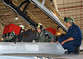 US Navy 070511-N-1082Z-005 Radio talk Show Host and Author, Laura Ingraham, receives a pre-flight brief from Lt. Ryan Fulwider and Aviation Structural Mechanic Equipmentman 2nd Class Jeremy Gottma.jpg