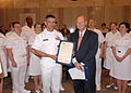 US Navy 070605-N-8497H-031 Director of Global Operations (J3) United States Strategic Command, Rear Adm. Doug McClain receives the Proclamation from Mayor Mick Cornett, declaring June 1-10 Oklahoma Navy week.jpg