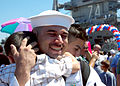 US Navy 070827-N-4007G-005 A Sailor greets his family after nearly an eight-month deployment aboard the Nimitz-class aircraft carrier USS John C. Stennis (CVN 74) at Naval Air Station North Island.jpg