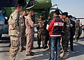 US Navy 071018-N-7415V-002 Rear Adm. Douglas McClain encourages members of the Afghan National Army Air Corps during a visit to the ANAAC base in Kabul.jpg