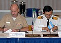 US Navy 071204-N-2821G-003 Argentine Navy Chief of Operations Capt. Waldemar Abel Sanguinetti, and U.S. Naval Forces Southern Command (NAVSO) Director of Exercises and Theater Security Cooperation (TSC) Capt. Steven Blaisdell r.jpg