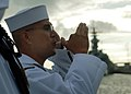 US Navy 071207-N-3283M-553 Boatswain's Mate 1st Class Juan Ramerez, assigned to Hawaii Regional Honor Guard, pipes attention during an interment ceremony for former USS Arizona (BB 39) crewmember Ensign Millard Ramsdell.jpg