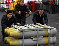 US Navy 080110-N-7526R-567 Sailors assigned to the weapons department of the Nimitz-class nuclear-powered aircraft carrier USS Ronald Reagan (CVN 76) move a pallet of ordnance through the hangar bay of the ship during an ammuni.jpg