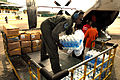 US Navy 080627-N-0640K-272 Aviation Structural Mechanic 2nd Class Myron Robertson, of Carson, Calif., stacks supplies onto a cart at Kalibo Airport.jpg