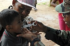 US Navy 080813-N-7544A-051 U.S. Air Force nurse 2nd Lt. Natalie R. McLendon gives a Nicaraguan child a shot of Pyrantel Pamoate, a de-worming medication, to cure and prevent parasite infection.jpg