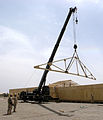 US Navy 090417-N-9599T-027 Seabees use a crane to place trusses on a Southwest Asia hut during a project at forward operating base Leatherneck.jpg