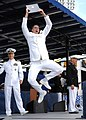 US Navy 090522-N-8395K-002 A newly commissioned ensign celebrates after receiving his diploma from Capt. Matthew Klunder, U.S. Naval Academy Commandant of Midshipmen, at the U.S. Naval Academy.jpg