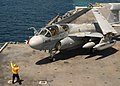 US Navy 090602-N-4938S-088 A plane director aboard the aircraft carrier USS George H.W. Bush (CVN 77) guides an EA-6B Prowler assigned to Electronic Attack Squadron (VAQ) 129.jpg