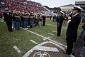 US Navy 091231-N-0696M-128 Adm. Mike Mullen, chairman of the Joint Chiefs of Staff, enlists 125 new service members at the 7th annual Bell Helicopter Armed Forces Bowl at Amon G. Carter Stadium in Fort Worth, Texas.jpg