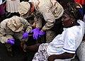 US Navy 100119-N-5244H-007 Two Hospital Corpsmen treat a Haitian woman's injured foot.jpg