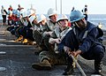 US Navy 100319-N-5538K-130 Sailors and Marines assigned to the forward-deployed amphibious transport dock ship USS Denver (LPD 9) hold a line to secure a span wire during a connected replenishment.jpg