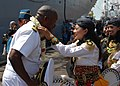 US Navy 100526-N-8539M-030 Capt. Rich Clemmons, commodore of Destroyer Squadron 31, receives a gift from dancers who performed a traditional welcome to the amphibious dock landing ship USS Tortuga (LSD 46).jpg