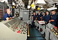 US Navy 100731-N-7948R-001 Hull Technician Gregory Ellis teaches midshipmen about the importance of damage control in damage control central aboard USS Pearl Harbor (LSD 52).jpg