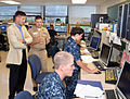 US Navy 100812-N-7682A-003 Juan M. Garcia III listens as Lt. Christopher L. May provides an overview of fundamental electronics training at the Center for Surface Combat Systems Unit technical training facility.jpg