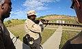 US Navy 101217-F-0651R-153 Line instructors observe Petty Officer 3rd Class Damarea Hutton ire a 12-gauge shotgun.jpg