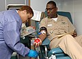 US Navy 110207-N-PS473-008 Senior Chief Culinary Specialist Edward Sivells gives blood during the Armed Services Blood Program blood drive at Comma.jpg