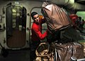 US Navy 110225-N-2937R-078 Aviation Ordnanceman Airman Blake Sanford separates bags of waste aboard the aircraft carrier USS Abraham Lincoln (CVN 7.jpg