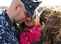 US Navy 110321-N-BT887-039 Hospital Corpsman 1st Class Edward Schulz embraces his family before deploying aboard the amphibious transport dock ship.jpg
